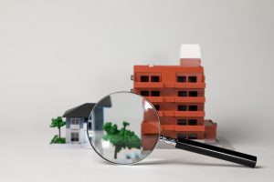 miniature models of residence and magnifying glass